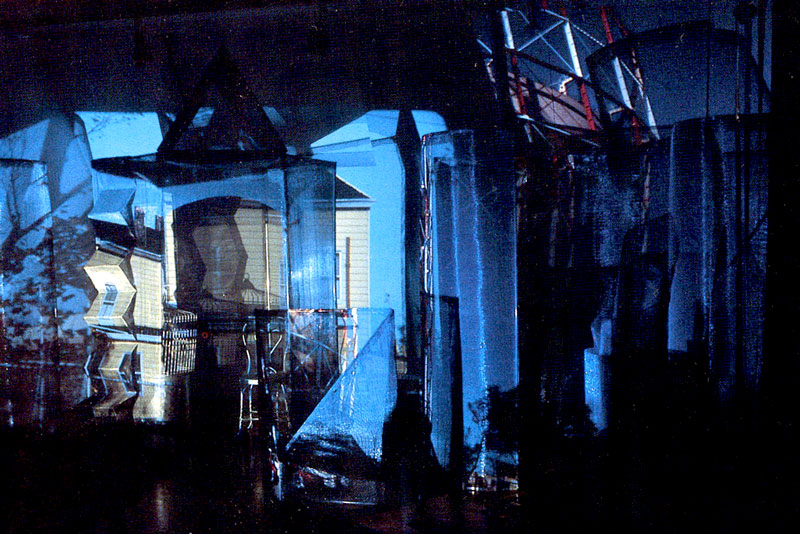 "Walk-in installation, ""City Visions"" solo exhibition, QCC Gallery, C.U.N.Y. 1988, with changing projections of Queens architecture surrounding viewers who walk through or sit in it."